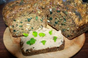 Seed bread with dried mallow added. A slice with bean humus and oxalis garnish