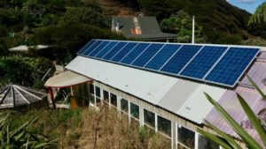 Solar panels, house behind